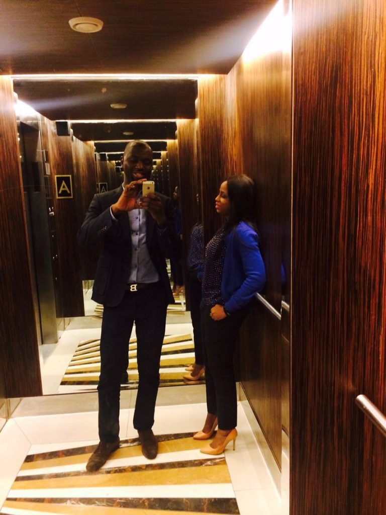 Kemi and Pelu taking a selfie in an elevator