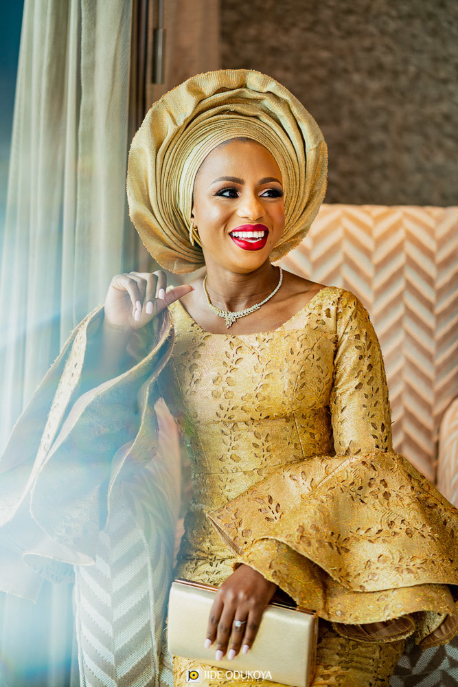 Kemi looking regal in her gold traditional outfit and laughing